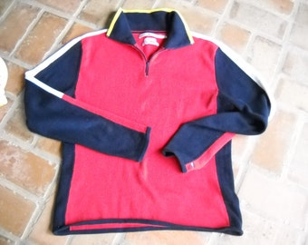 Collectible Tommy Hilfiger Ski sweater from the 90s, Size M to L, 92 percent cotton, and nylon, Traditional Red, White, Blue and Yellow