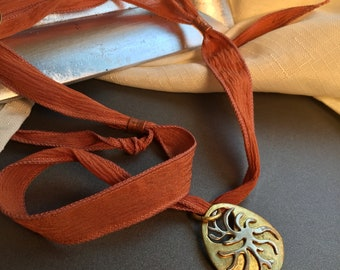 Ala Matisse brass and german silver pendant on adjustable chenille ribbon