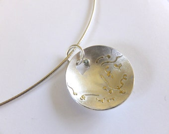 Domed silver pendant with 18 carat gold design and aquamarine