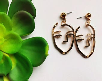 The stencil side face earrings