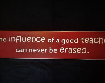 The influence of a good teacher can never be erased wooden sign