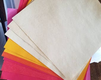 Set of 13 papers - yellows, orange, reds, and pink - great for scrapbooking, mixed media, cards, etc.