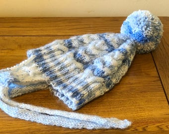 Handmade cabled babies hat