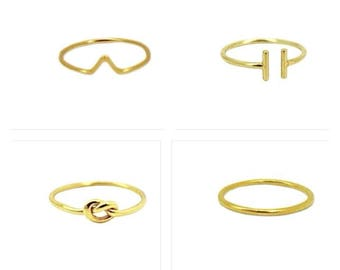 SET of four knuckle M.A.STONE vermeil rings.