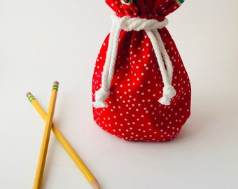 Red polka dot drawstring bag