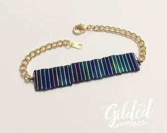 Discoveries Bracelet — dark rainbow czech glass midnight oil slick bugle trans ally pride purple black gold layering arm party wrist candy