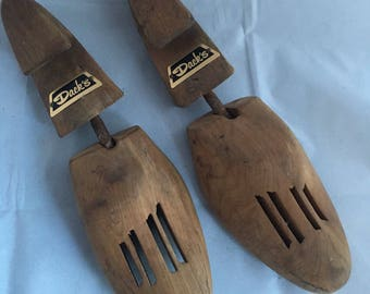 Antique solid wood shoe stretchers. Dacks of Toronto wooden shoe stretchers. Wooden shoe trees.
