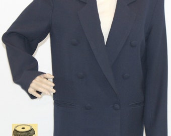 Navy blue rayon blazer with deep notched lapel/slit pockets and cloth covered button front enclosure. By Gianni