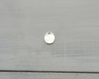 Silver 10x08mm oval sequins