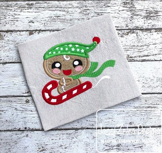 Ginger bread boy on candy cane sled appliqué embroidery design - Christmas appliqué design - ginger bread appliqué design - boy appliqué