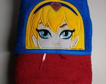 Hooded towel with Supergirl peeker.
