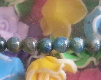 1 Pearl apatite 6 mm diameter, hole 1 mm