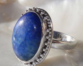 Lapis Lazuli cabochon and silver mount with granulations ring