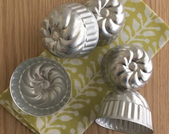 Round aluminum tins or molds 5 pieces vintage