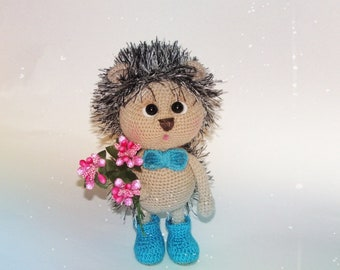 knitted hedgehog with flowers