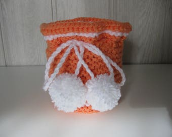 box dressed in wool and her pom poms