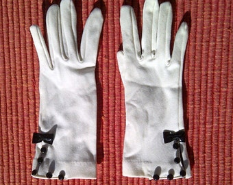 Vintage white stretch cloth gloves with black patent leather bow and buttons