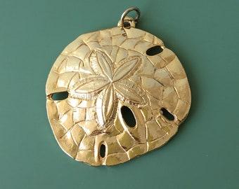 Vintage sand dollar pendant .