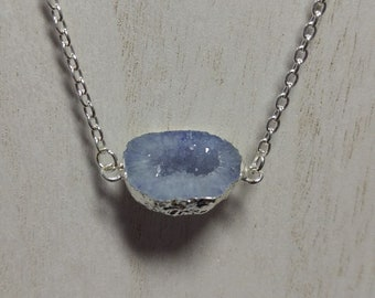 Light blue druzy set in silver plate