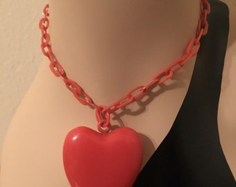 1930s red celluloid chain with puffy heart pendant