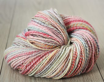 Handspun yarn, 98g, 197m, DK-weight, Superwash Bluefaced Leicester (BFL) in 'The Juggler', pastels pink, blue, red, yellow, natural, white