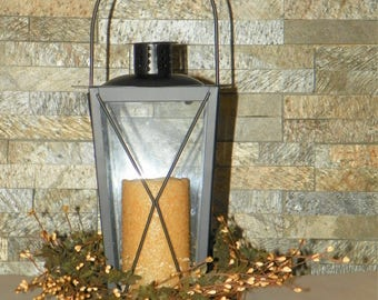 Black Lantern with a LED Timer Pillar Candle and Decorated with a Rustic Pip Berry Ring of Sage Green, Ivory, grapevine and Primitive Leaves