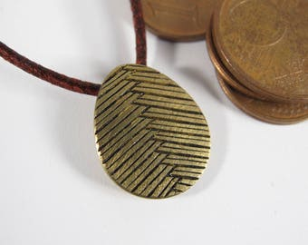 "Pendant egg ""Braid"" engraved handmade raw brass patina, knotted tie choice"