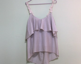 Top Carles. Double Top flounce. Top over with shoulder pads. Top with lace straps. Milk tops with pastel polka dots. One size