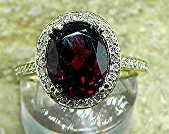 AAA Pyrope Garnet   10x8mm  3.10 Carats   in a 14k Yellow gold ring with diamonds (.32ct) Ring 1817