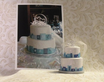 A mini version of your wedding or special occasion cake turned into an ornament, made out of paper!