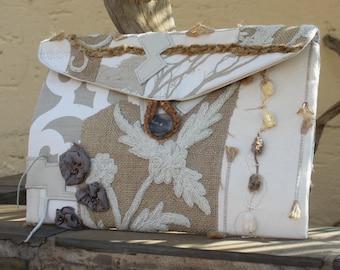 Clutch purse , Envelope clutch bag , Hand bag , Embellished clutch , Textured clutch , Designer clutch .