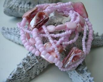 8 pink bracelets
