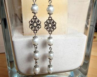 Earrings long white pearl beads