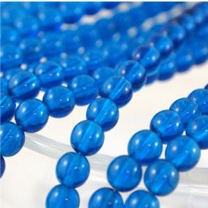 6mm Druk Pressed Beads-Capri Blue-Qty 25 (CZ 6R CB)