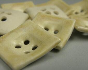 ceramic buttons--square--creamy white/orange
