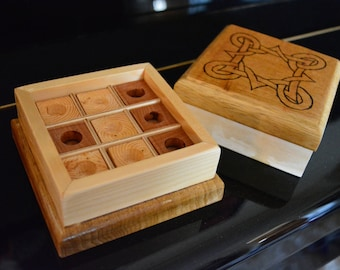 Wooden tic tac toe game with pyrography cover
