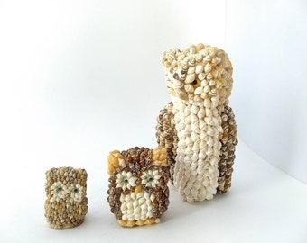 Set of three vintage sea shell owl figurines