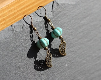 ethnic earrings, bronze shades, and turquoise howlite flower