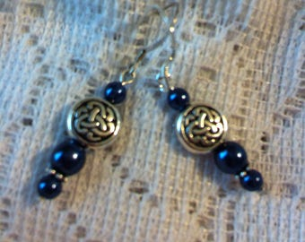 Dark blue and silver pierced earrings with Celtic knot beads