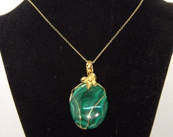 Wire wrapped Necklace, Malachite stone wrapped in gold colored wired on gold chain.  Handmade