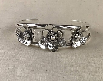 Small Silver Cuff Bracelet With Three Flowers
