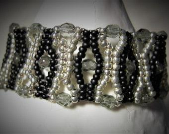 Silver and black XOXO bracelet