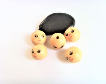 Round head face wood beads.