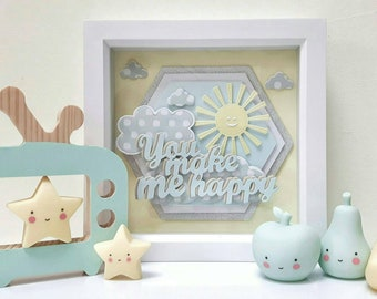 Neutral framed sunshine and clouds nursery children's room decoration.