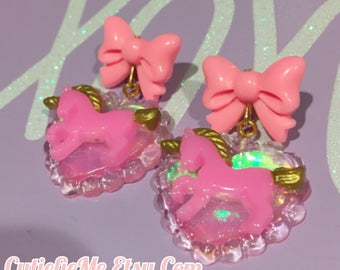 Pink Unicorn On A Holographic Heart And Bow Dangle Earrings