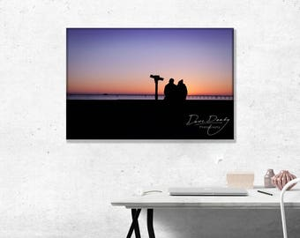 Couple sitting on Southend Sea Wall watching the Sunset. Photo Wall Art Print