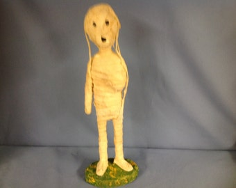 Paper mâché sculpted Halloween mummy figure.
