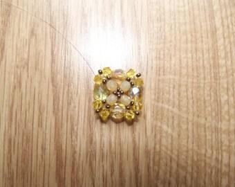 Yellow swarovski ring.