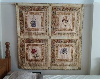 Gardeners delight quilt or wall hanging depicting botanically drawn flowers all hand quilted.