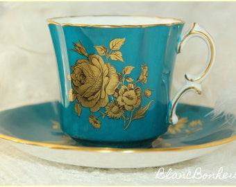 Hammersley, England: Blue tea cup & saucer with gold roses